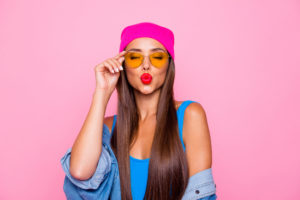 Close up photo portrait of winsome pretty cute lovely sweet glad nice lady sending kiss to you wearing orange transparent glasses closed eyes isolated pastel background