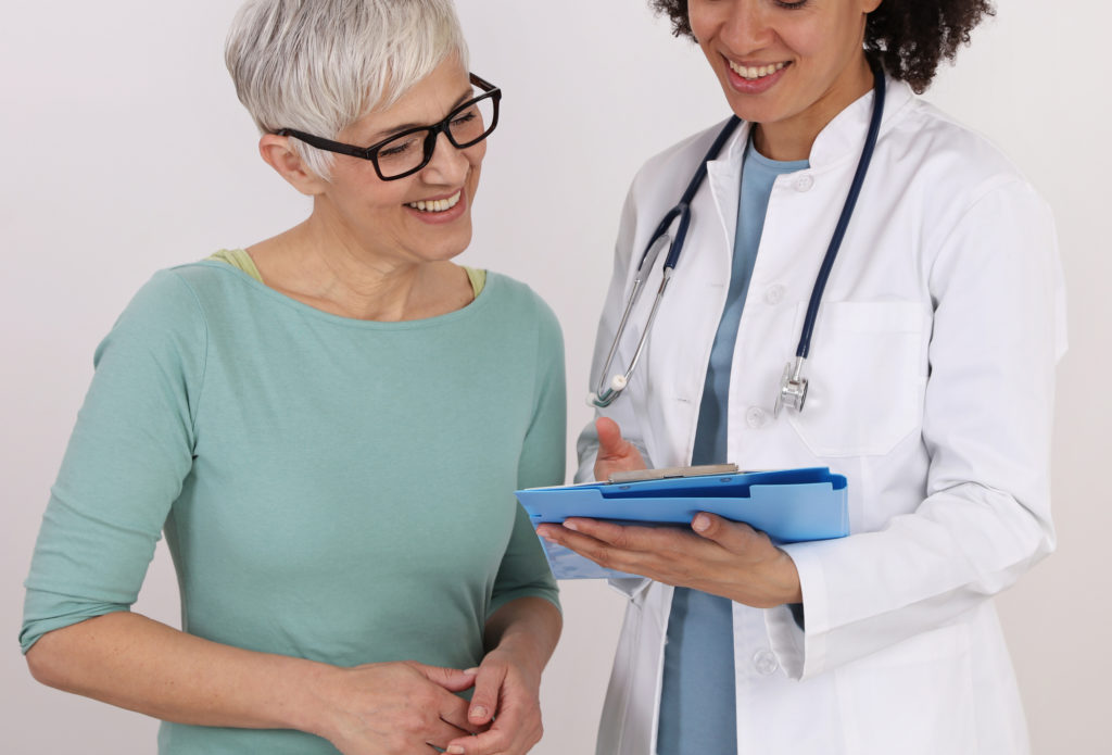 Doctor and mature female Patient discussing treatments for menopause.