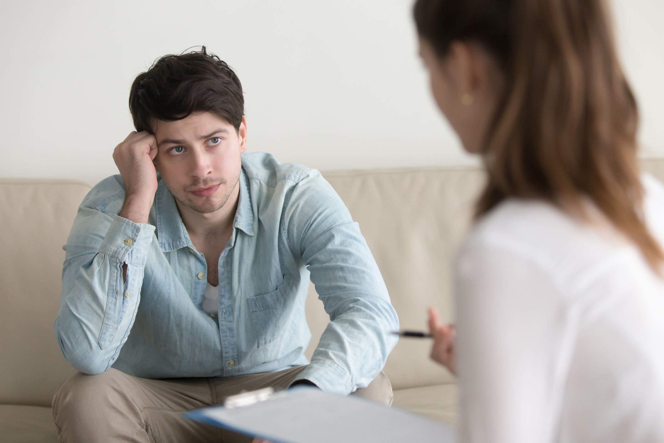 Male patient talking to female doctor about andropause